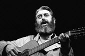 Richard's Cork Leg by Brendan Behan with Irish folk band, The Dubliners, Royal Court Theatre, London, 1972. Ronnie Drew plays guitar. - Patrick Eagar - 1970s,1972,ACE,act,acting,actor,actors,arts,band,bands,cities,city,Court,culture,drama,DRAMATIC,entertainment,guitar,guitarist,guitars,instruments,Irish,London,maker,makers,making,male,man,melody,men,