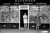 Shopfront in Kirkby, Liverpool, early 1970's - Peter Harrap - 1970s,1973,bedding,carpets,drapery,EBF,Economic,Economy,female,green,linos,Liverpool,local,people,person,persons,poor,shield,SHIELDS,shop,stamps,woman,women