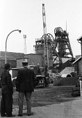 Workers at Markham Main Colliery in Derbyshire look towards the pitshaft, site of a lift shaft accident at the pit on 30th July, 1973 which resulted in the deaths of 18 of their workmates. - Peter Harrap - 10-08-1973