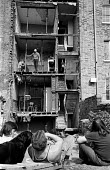 Builders wait to start work as Mr Hefford, resident at Brooksby Street in Islington for 47 years, resists forced eviction from his house due to redevelopment in the mid 1970's. - Peter Harrap - 1970s,1974,activist,activists,against,CAMPAIGN,campaigner,campaigners,CAMPAIGNING,CAMPAIGNS,dangerous,DEMONSTRATING,DEMONSTRATION,DEMONSTRATIONS,developer,developers,DEVELOPMENT,evicted,eviction,facad