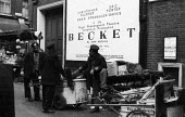 Street cleaners take a break from their work by a theatre, West End, London 1961. - Romano Cagnoni - 1960s,1961,BAME,BAMEs,Becket,black,BME,bmes,break,break time,breaktime,cities,city,cleaner,cleaners,CLEANING,cleansing,communicating,communication,conversation,conversations,COUNCIL SERVICES,COUNCIL S