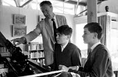Composer, Benjamin Britten, tutoring two young boys at his home, Aldeburgh, Suffolk. .... - Romano Cagnoni - 1960s,1964,ACE,arts,Benjamin,boy,boys,Britten,child,CHILDHOOD,children,composer,culture,home,instruments,juvenile,juveniles,kid,kids,learn,learning,male,melody,music,MUSICAL,musical instrument,musicia