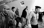 Dockside workers at the harbour, Lisbon, Portugal 1968 - Romano Cagnoni - , EBF,1960s,1968,berth,berthed,boat,boats,casual workers,cities,city,COAST,coastal,coasts,crew,crewman,crewmen,crewmenmaritime,DOCK WORKER,DOCK WORKERS,docked,docker,dockers,Dockside,dockworker,dockwo