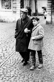 Man and young boy walking down the street, Lisbon, Portugal, 1968. - Romano Cagnoni - 06-03-1968