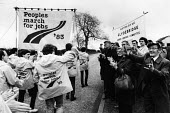 The Peoples March For Jobs is greeted enthusiastically by supporters just before crossing the border from Scotland into England at Gretna Green 1983 - Rick Matthews - 1980s,1983,activist,activists,adult,adults,against,AGE,ageing population,and,applauding,applause,banner,banners,border,campaign,campaigner,campaigners,campaigning,CAMPAIGNS,clap,clapping,cross,crosses