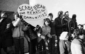 Miners supporters holding a banner reading Scabs Break The Hearts of Communities during a mass picket by womens support groups and miners at Polkemmet Colliery near Edinburgh, Scotland during the mIne... - Rick Matthews - 14-02-1985