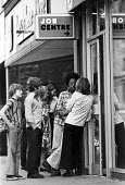 Unemployed school leavers, all with GCSE and CSE passes in their exam results, outside the Job Centre, Westoe, South Shields, summer 1975 - Ray Smith - 1970s,1975,adolescence,adolescent,adolescents,agency,BAME,BAMEs,BEMM,BEMMs,black,BME,bmes,boy,boys,child,CHILDHOOD,children,cities,City,communicating,communication,conversation,conversations,dialogue,