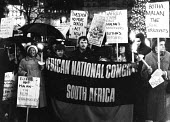 AAM supporters stage a torchlit vigil outside South Africa House in protest against the apartheid regime's military attack on its frontline neighbour, Lesotho, resulting in the deaths of 42 South Afri... - Stefano Cagnoni - 12-12-1982
