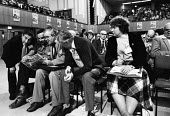 Frank Chapple and others reading News Line newspaper TUC conference, Brighton, 1982. Woman delegate to TUC isolated and left out of discussion in an overwhelmingly male dominated trade union delegatio... - Stefano Cagnoni - 09-09-1982