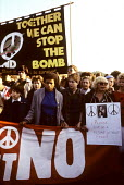 Young people at a CND rally in Hyde Park in 1983. - Stefano Cagnoni - (CND),1980s,1983,activist,activists,adolescence,adolescent,adolescents,Anti War,anti-nuclear,Antiwar,atomic,BAME,BAMEs,banner,banners,black,BME,bmes,Bomb,BOMBS,campaign,Campaign for Nuclear Disarmamen