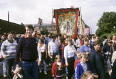 The banner carried by striking miners from Monkwearmouth Lodge, Durham Miners Gala, July,1984. - Stefano Cagnoni - 1980s,1984,Big Meeting,child children,County Durham,disputes,family families,INDUSTRIAL DISPUTE,member,member members,members,MINER,miners,MINER'S,miners strike,miners' strike,miners strike miner's st