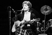 Folk singer and activist, Peggy Seeger, performing at the Here We Go benefit gig in support of the miners strike, London, 1984. - Stefano Cagnoni - 1980s,1984,ACE,Arts,cities,city,culture,disputes,entertainment,FEMALE,guitar,INDUSTRIAL DISPUTE,London,melody,member,member members,members,MINER,miners,MINER'S,Miners Strike,Miner's Strike,music,MUSI