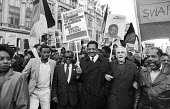 1985 Protest for sanctions against South Africa, the release of Nelson Mandela, and an end to apartheid - Oliver Tambo, ANC, Jesse Jackson and Trevor Huddleston at the front of the march, London - Stefano Cagnoni - 02-11-1985