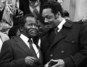 National rally calling for for sanctions against South Africa, the release of Nelson Mandela, imprisoned in South Africa and an end to apartheid. President of the ANC, Oliver Tambo and Jesse Jackson o... - Stefano Cagnoni - 1980s,1985,AAM,activist,activists,Africa,against,Anti Apartheid Movement,Anti-Apartheid,black,CAMPAIGN,campaigner,campaigners,CAMPAIGNING,CAMPAIGNS,demonstrate,DEMONSTRATING,demonstration,DEMONSTRATIO