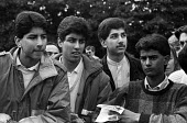 Young Asian men in Leytonstone in the mid 1980's gathered for a rally called to defend the black and ethnic minority community from racist attacks. - Stefano Cagnoni - 1980s,1985,activist,activists,adolescence,adolescent,adolescents,Anti Racism,anti racist,asian,asians,BAME,BAMEs,bigotry,BME,bmes,CAMPAIGN,campaigner,campaigners,CAMPAIGNING,CAMPAIGNS,communities,comm
