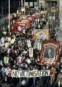 One year into the MIners Strike of 1984-85, mIners from the NUM carry the banner from Bentley Colliery in Yorkshire and a banner reading No Victimisation on a march through London against Government a... - Stefano Cagnoni - 06-03-1985