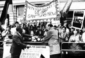 AAM supporters stage a vigil at a Commonwealth mini-summit in London. ANC Sec Gen, Alfred Nzo, and Bob Hughes MP place a wreath on a coffin symbolising all those who have died in South African attacks... - Stefano Cagnoni - 1980s,1986,AAM,activist,activists,African,against,Alfred,ANC,Anti Apartheid Movement,anti-apartheid,Bob,CAMPAIGN,campaigner,campaigners,CAMPAIGNING,CAMPAIGNS,casket,cities,city,coffin,DEMONSTRATING,de