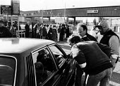 Ford workers from the Dagenham plant trying to persuade their fellow workers not to cross their picket line during an official dispute in support of higher pay at the car production company. - Stefano Cagnoni - 1980s,1988,7,AEEU,AUTO,AUTOMOBILE,AUTOMOBILES,automotive,car,car cars,car industry,car worker,carindustry carindustry,cars,communicating,communication,conversation,Dagenham,dialogue,dispute,DISPUTES,F
