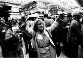 Supporter of MILITANT selling copies of their newspaper, Labour Party Conference 1982 - John Smith - 1980s,1982,Conference,conferences,entryism,entryist,entryists,entyrism,expel,expelling,expulsion,Labour Party,left,left wing,leftwing,marxist,Marxists,MILITANT,Militant Tendency,newspaper,newspaper ne