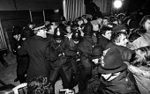 Stockport Messenger Police officers grapple with trade union members at a mass picket in support of NGA members on strike in a dispute with Eddie Shahs Messenger Newspaper Group over his use of non-un... - John Smith - 29-11-1983