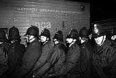 Stockport Messenger Police officers at a mass picket in support of NGA members on strike in a dispute with Eddie Shahs Messenger Newspaper Group over his use of non-union scab workers to typeset MNG p... - John Smith - 29-11-1983