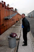 Sean Draper, chaplain's assistant at Mersey Mission to Seafarers, waiting to board a ship in Liverpool docks. - Rob Bremner - 26-03-2004