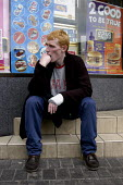 A man sitting outside a branch of Wimpy, City centre, Liverpool. - Rob Bremner - 08-08-2004