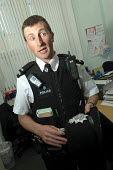 Police constable Chris Brown, a community safety officer in the Bootle area of Merseyside. He is talking to a housing officer in the area about the problems. - Rob Bremner - 2000s,2006,adult,adults,against,anti,anti social behavior,anti social behaviour,anti socialanti social behavior,antisocial,antisocial behaviour,antisocial behaviour order,asbo,asbos,behavior,behaviour