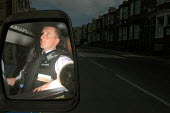Police constable Chris Brown, a community safety officer in the Bootle area of Merseyside, on patrol. - Rob Bremner - ,2000s,2006,adult,adults,against,anti,anti social behavior,anti social behaviour,anti socialanti social behavior,antisocial,antisocial behaviour,antisocial behaviour order,asbo,asbos,beat,behavior,beh