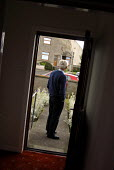 A man who suffers from dementia and has a heart condition, at his front door in Caithness. - Rob Bremner - ,2000s,2007,age,ageing population,alzheimirs,and,angina,brain,caithness,cognitive,council,dementia,deterioration,elderly,functions,hea health,house,houses,housing,ill,illness,ILLNESSES,intellectual,lo