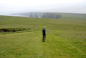 Man who suffers from dementia and has a heart condition, Duncansbay Head in Caithness. - Rob Bremner - 2000s,2007,adult,adults,AGE,ageing population,alzheimirs,angina,dementia,duncansbay head,ELDERLY,hea health,MATURE,OAP,OAPS,OLD,PENSION,pensioner,PENSIONERS,PENSIONS,pentland Firth,person,persons,RETI