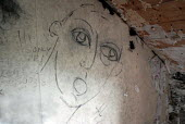 A drawing of a man on the wall of an abandoned cottage, Caithness, Scotland. - Rob Bremner - 01-10-2005