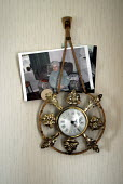 A photograph of a woman who died of pics disease, an inherited form of dementia. The picure was placed behind the clock by her husband William who also has severe dementia. - Rob Bremner - 09-10-2005