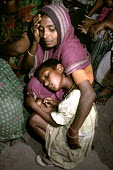 Mother and child Calcutta. - Rob Bremner - 2000s,2004,Asia,asian,asians,asleep,child,CHILDHOOD,children,cities,city,EQUALITY,excluded,exclusion,EXHAUSTION,FEMALE,HARDSHIP,homeless,homelessness,impoverished,impoverishment,indian,indian subconti