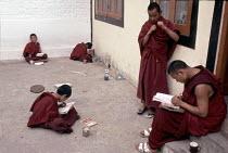 Monks Studying Darhamsala, India. - Rob Bremner - 2000s,2006,Asia,asian,asians,buddha,buddhism,buddhist,buddhists,Dharamsala,Dharmcala,indian,indian subcontinent,Indians,LEARNING,monk,monks,rlb religion & belief,STUDY,Studying