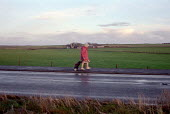 A pensioner walking to the shops, in rural Scotland. - Rob Bremner - 1990s,1999,adult,adults,age,ageing population,Bag,bags,bought,buy,buyer,buyers,buying,commodities,commodity,consumer,consumers,country,countryside,croft,customer,customers,elderly,FEMALE,field,fields,