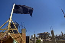 "Black Nakba flag flying at Nahr al-Bared Palestinian refugee camp. Nakba in Arabic means ""Catastrophe . - Ron Coelle - 2000s,2007,2008,Agency,ahr al Bared,ahr el-Bared,aid agency,al-Bared,and,assistance,black,building,buildings,camp,camps,conflict,crisis,destroyed,destruction,diaspora,displaced,East,flag,flags,flying,"