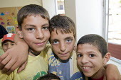 Children in a temporary classroom at Nahr al-Bared Palestinian refugee camp. - Ron Coelle - 2000s,2008,agencies,Agency,ahr al Bared,ahr el-Bared,aid,aid agency,al-Bared,and,assistance,boy,boys,camp,camps,charitable,charities,charity,child,CHILDHOOD,children,class,classroom,classrooms,crisis,