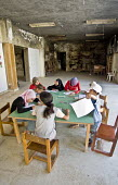 Children in a temporary classroom, at Nahr al-Bared Palestinian refugee camp. - Ron Coelle - ,2000s,2007,2008,activities,agencies,Agency,ahr al Bared,ahr el-Bared,aid,aid agency,al-Bared,and,art,assistance,book,books,boy,boys,burn,burning,BURNS,burnt,camp,camps,charitable,charities,charity,ch