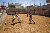 Children playing football at Nahr al-Bared Palestinian refugee camp. - Ron Coelle - ,2000s,2008,Agency,ahr al Bared,ahr el-Bared,aid agency,al-Bared,and,areas,assistance,boy,boys,camp,camps,child,CHILDHOOD,children,crisis,Diaspora,displaced,East,exercise,exercises,exercising,football