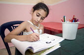 Schoolgirl in a temporary classroom, at Nahr al-Bared Palestinian refugee camp. - Ron Coelle - ,2000s,2008,activities,agencies,Agency,ahr al Bared,ahr el-Bared,aid,aid agency,al-Bared,and,art,assistance,book,books,camp,camps,charitable,charities,charity,child,CHILDHOOD,children,class,classes,cl