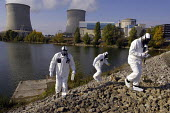 Workers simulate a nuclear accident EDF Nuclear Power Plant, France. Firefighters in protective NBC suites take samples to ditermine the extent of radioactive contamination. - Pierre GLEIZES - 11-10-2005