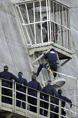 Police try to stop a Greenpeace Action on a cooling tower of the central nuclear EDF, Dampierre en Burly, France - Pierre GLEIZES - 19-10-2007