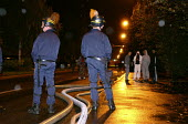 Another violent night in the Paris suburbs. A garage, Renault car dealer is set ablaze. 120 CRS (riot police officers) and 200 firefighters intervene. Safety zone secured by policemen, police officers... - Sebastien ORTOLA - 07-11-2005