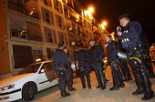 8th night of riots and urban violence in the Eastern outskirts of Paris. Inspection of a housing project in Le Blanc-Mesnil. Team of police officers, prevention - Sebastien ORTOLA - 04-11-2005