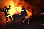 8th night of riots and urban violence in the Eastern outskirts of Paris. Firefighters intervene, fire, vehicle set ablaze in Le Blanc-Mesnil - Sebastien ORTOLA - 04-11-2005