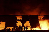 8th night of riots and urban violence in the Eastern outskirts of Paris. Timber warehouse (from the Panofrance Barjonet wholesaler) set on fire at Le Bourget. Intervention of firefighters equiped with... - Sebastien ORTOLA - 04-11-2005
