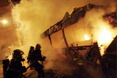 Urban riots in Toulouse (Southwestern France). Firefighters intevene on a bus , set ablaze, at the beginning of the 12th night of urban violence in the district of la Reynerie, Toulouse - Jean Philippe Arles - 07-11-2005