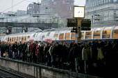 Passengers disembark onto the platform from one of the few trains in service. Transport strike, Lazare Saint railway station, Paris. Strike over planned job cuts, pensions and higher wage demands. Fra... - Gilles ROLLE - 2000s,2007,adult,adults,carriage,carriages,cities,city,COMMUTE,commuter,commuters,commuting,cuts,disputes,EARNINGS,EBF Economy,eu,Europe,european,europeans,eurozone,france,french,from work,INDUSTRIAL