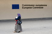 Roma woman migrant with child passing the European Commission, Brussels, Belgium. The EU has rebuked the French government for deporting hundreds of Roma migrants back to Romania and Bulgaria. - Wiktor Dabkowski - 2010,2010s,adult,adults,BAME,BAMEs,bigotry,BME,bmes,child,CHILDHOOD,children,clj,deportation,deporting,Diaspora,discrimination,diversity,equal,equality,ethnic,ethnicity,eu,European,europeans,families,